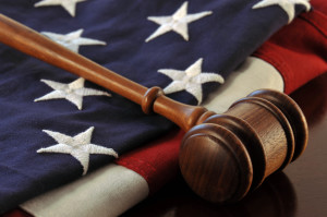 Wooden judge's gavel over an American flag
