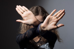Out of focus woman with her hands signaling to stop isolated
